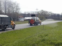 Chemical Truck Spraying a Roadside